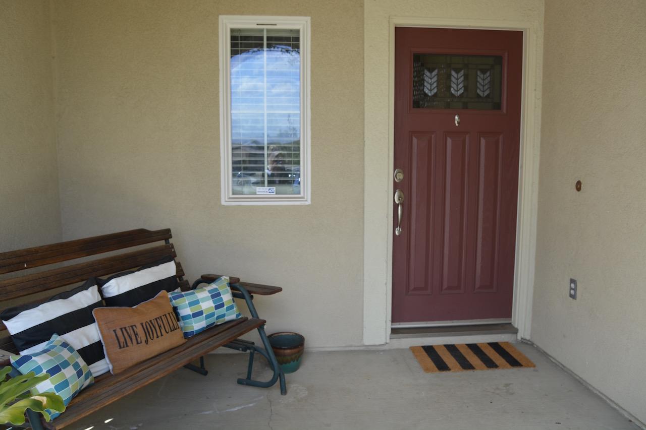 Beige and burgundy front door exterior