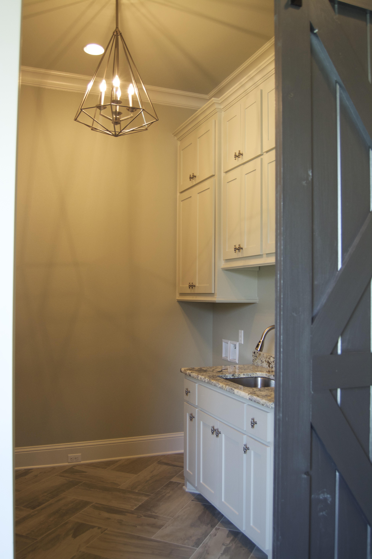 Laundry room with dutch door