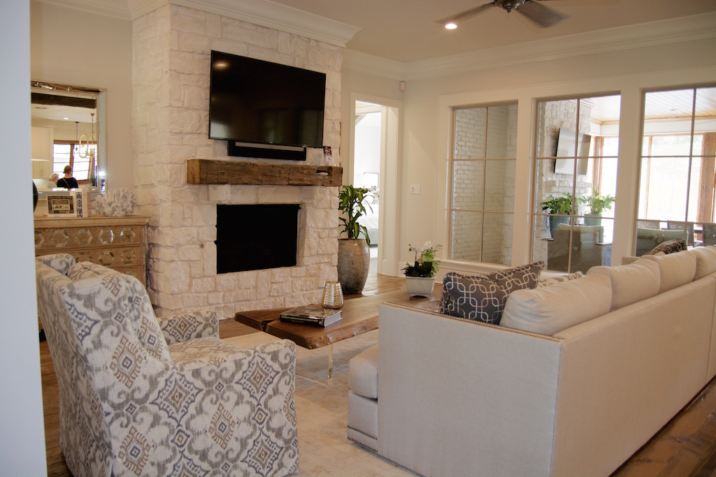 Texas limestone fireplace wood beam mantle contemporary transitional living room