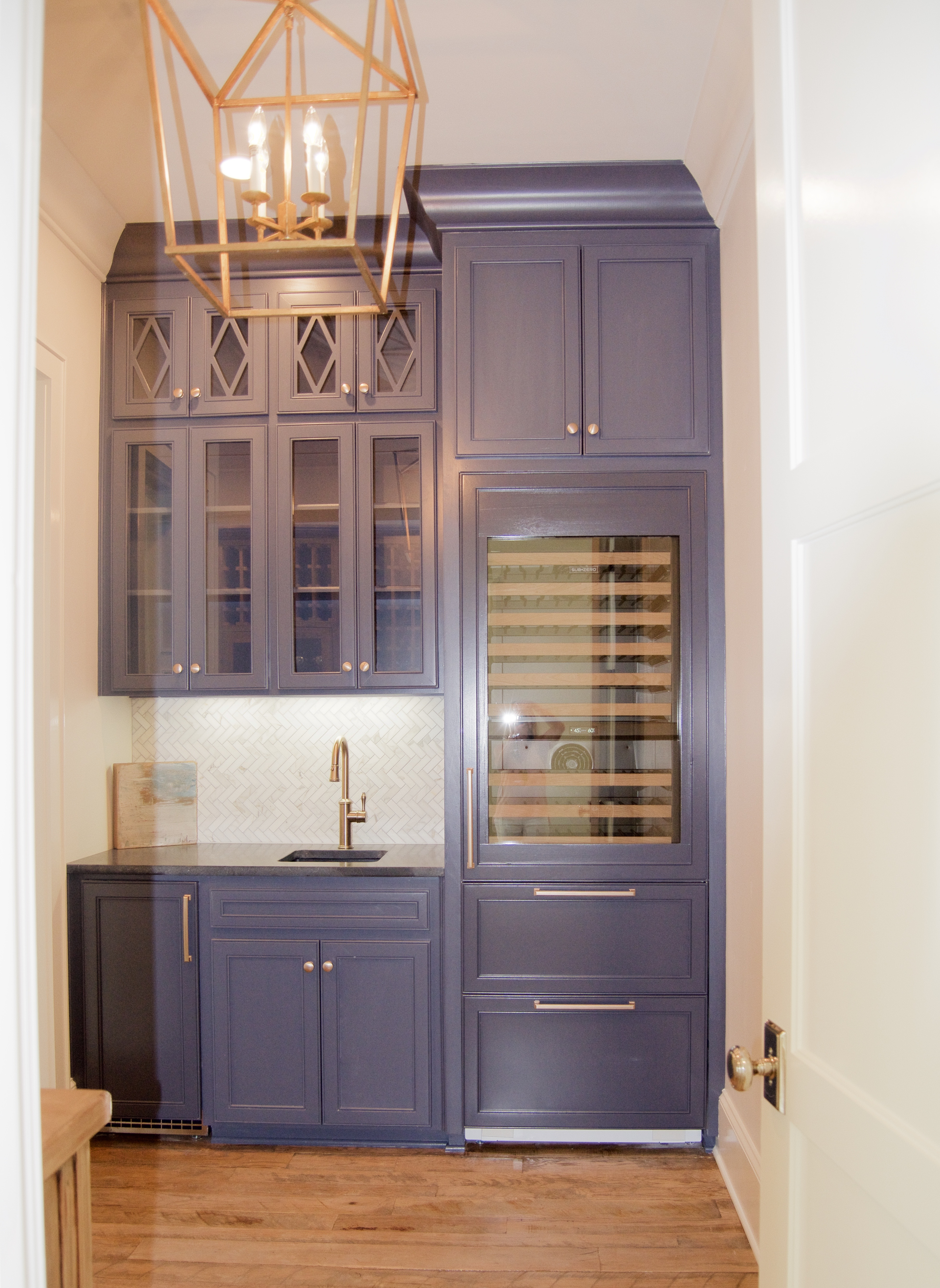 butlers pantry navy cabinets wine fridge