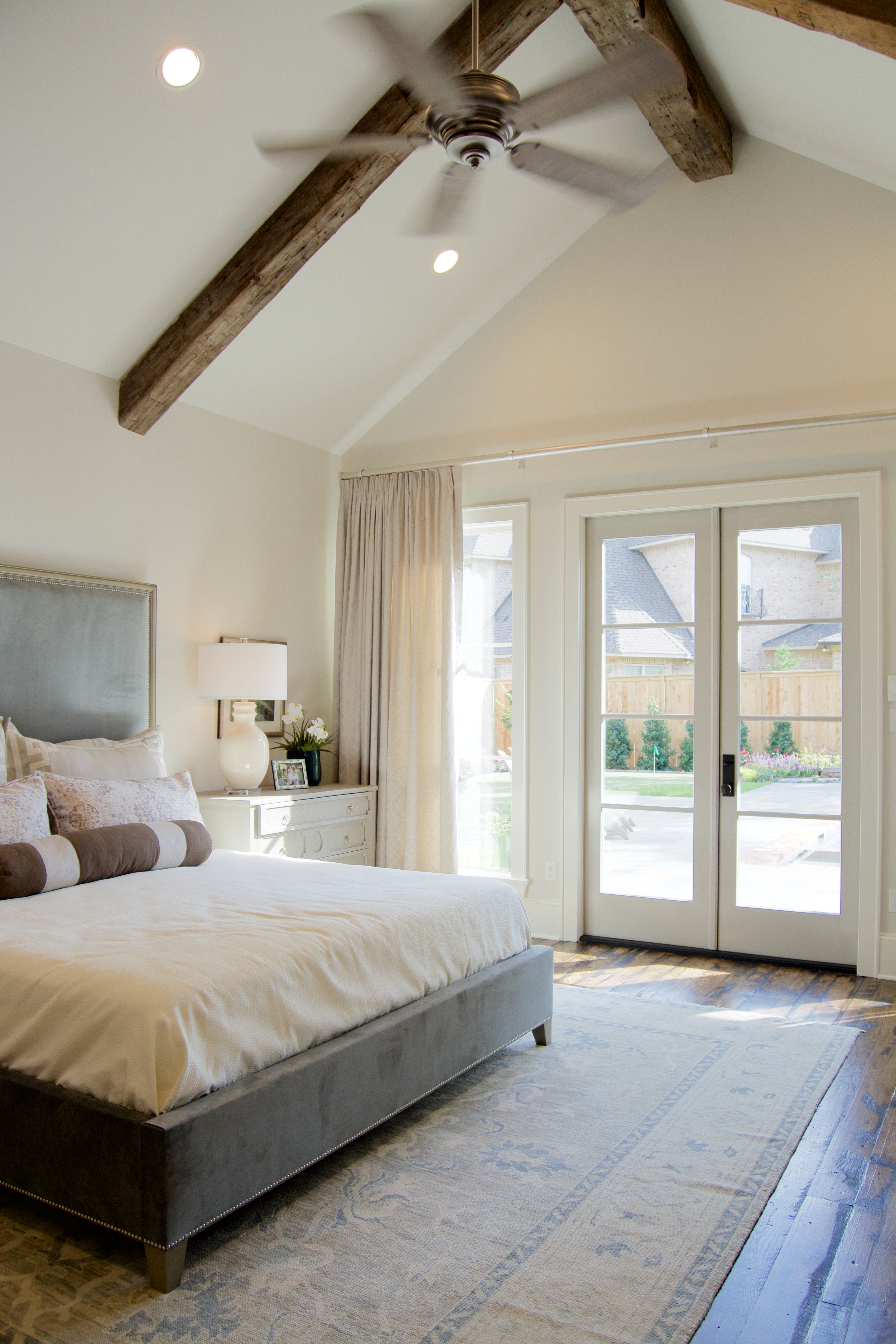 Contemporary bedroom vaulted ceiling beams gray white