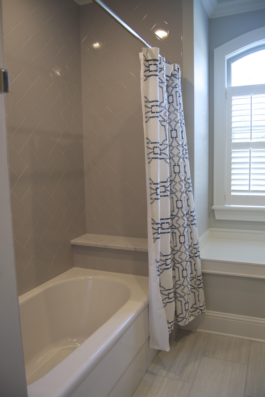 gray shower design subway tile turned herringbone pattern