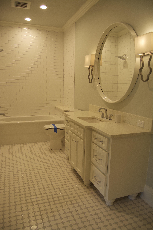 White bathroom round mirror brass sconces