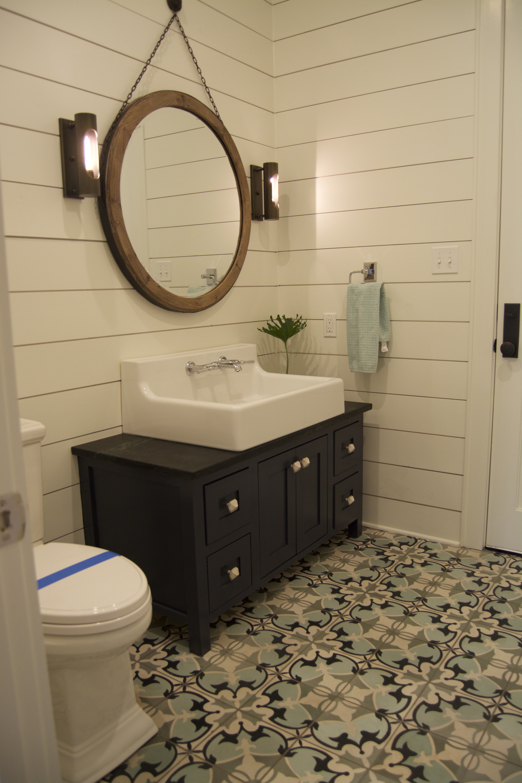Ryan Smith builders navy vanity shiplap cement tile floor