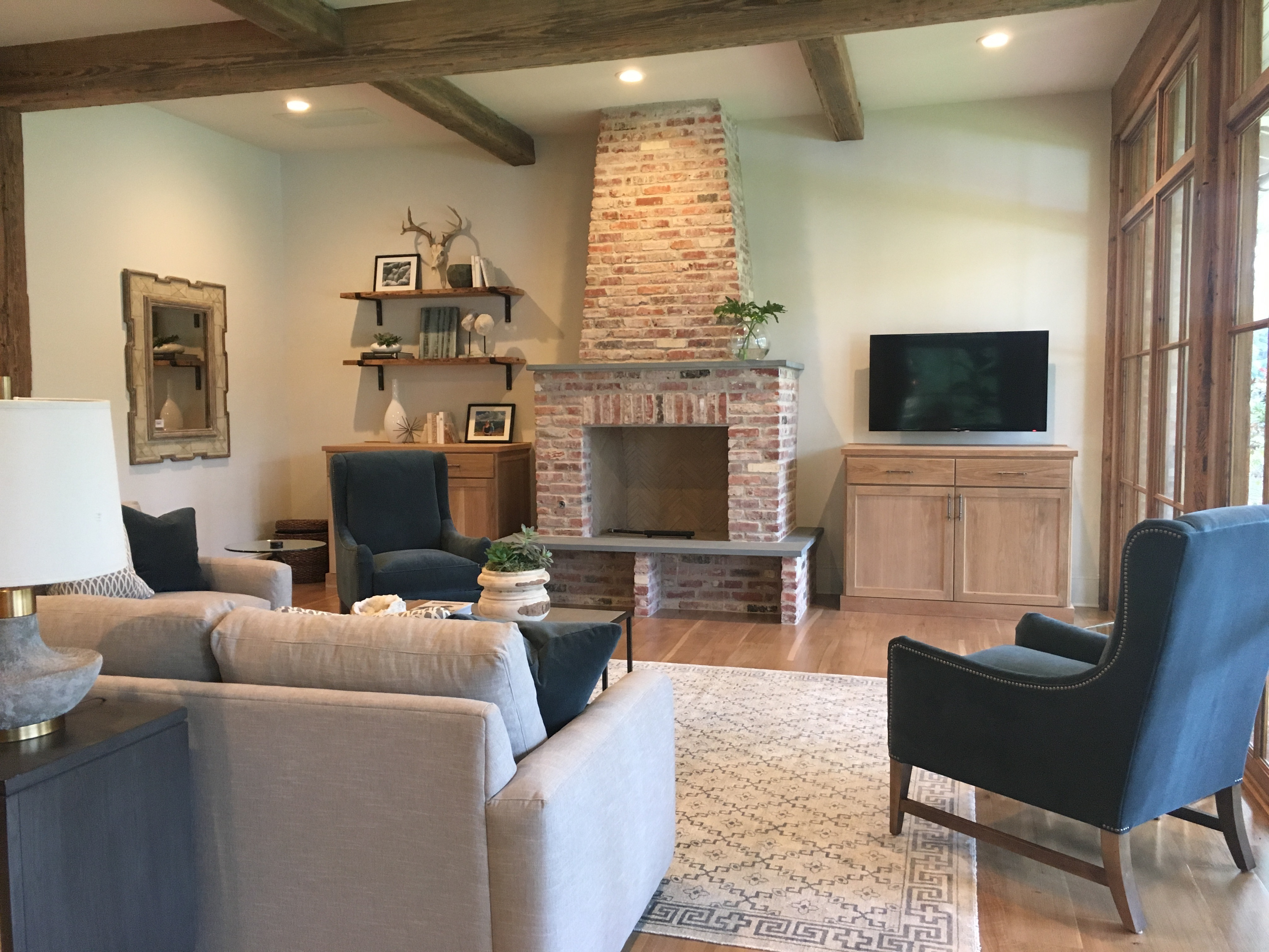beamed ceiling brick fireplace simple decor