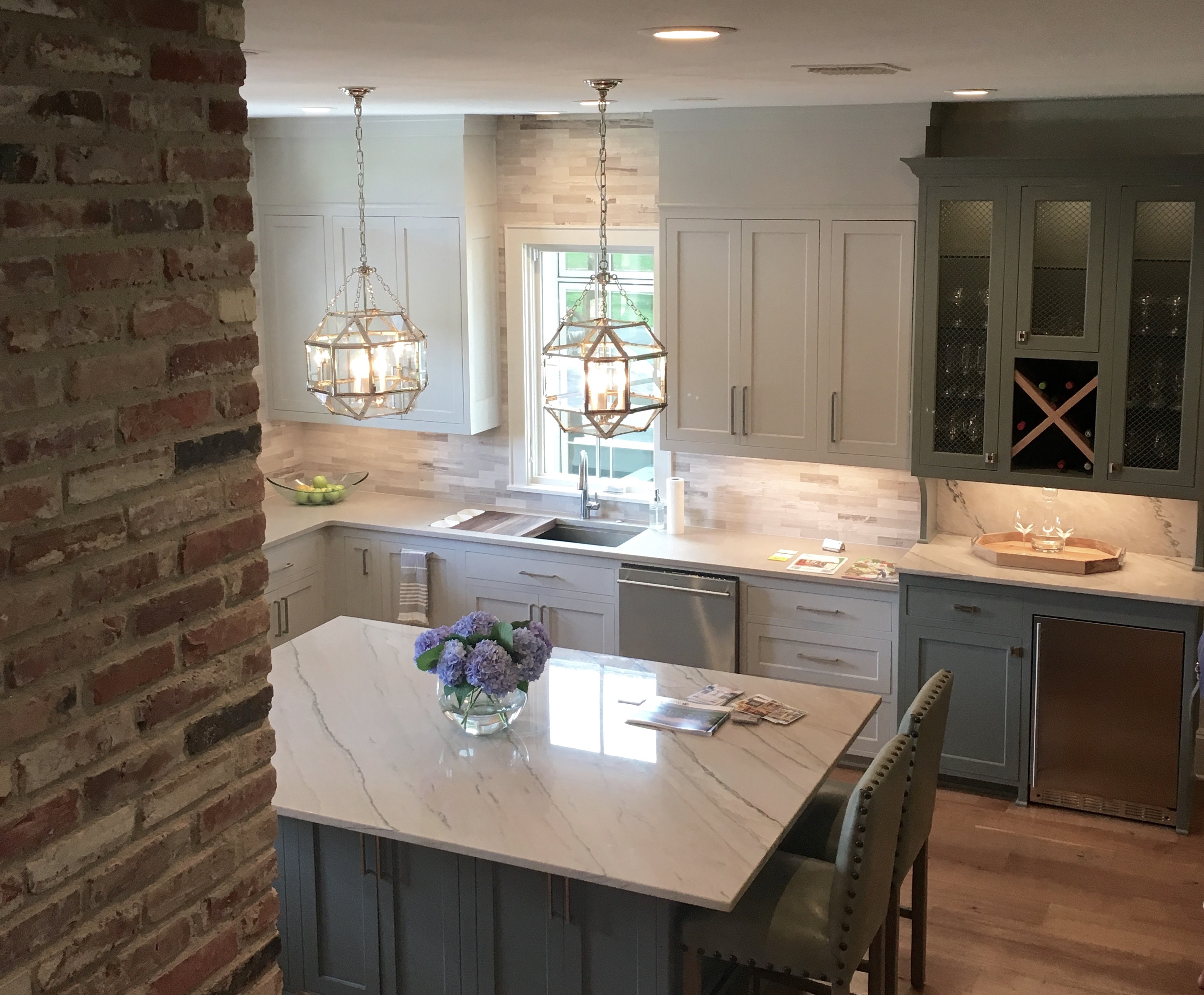 two toned gray kitchen quartzite and exposed brick