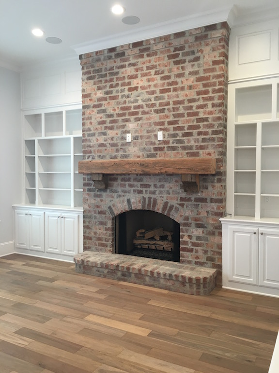Brick fireplace beam mantle white built-ins