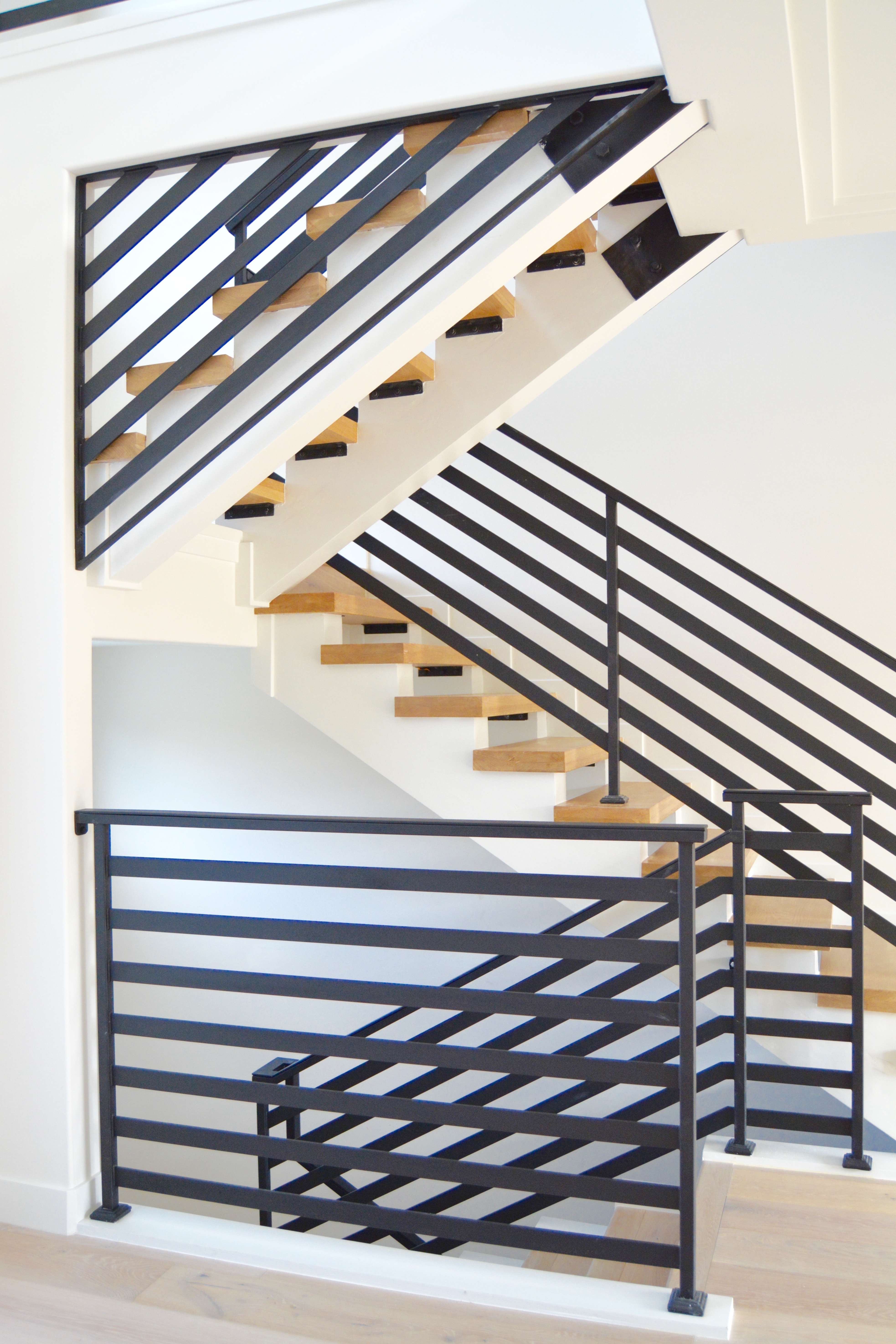 Black steel iron railing floating staircase modern fish and arrow interiors twg contracting