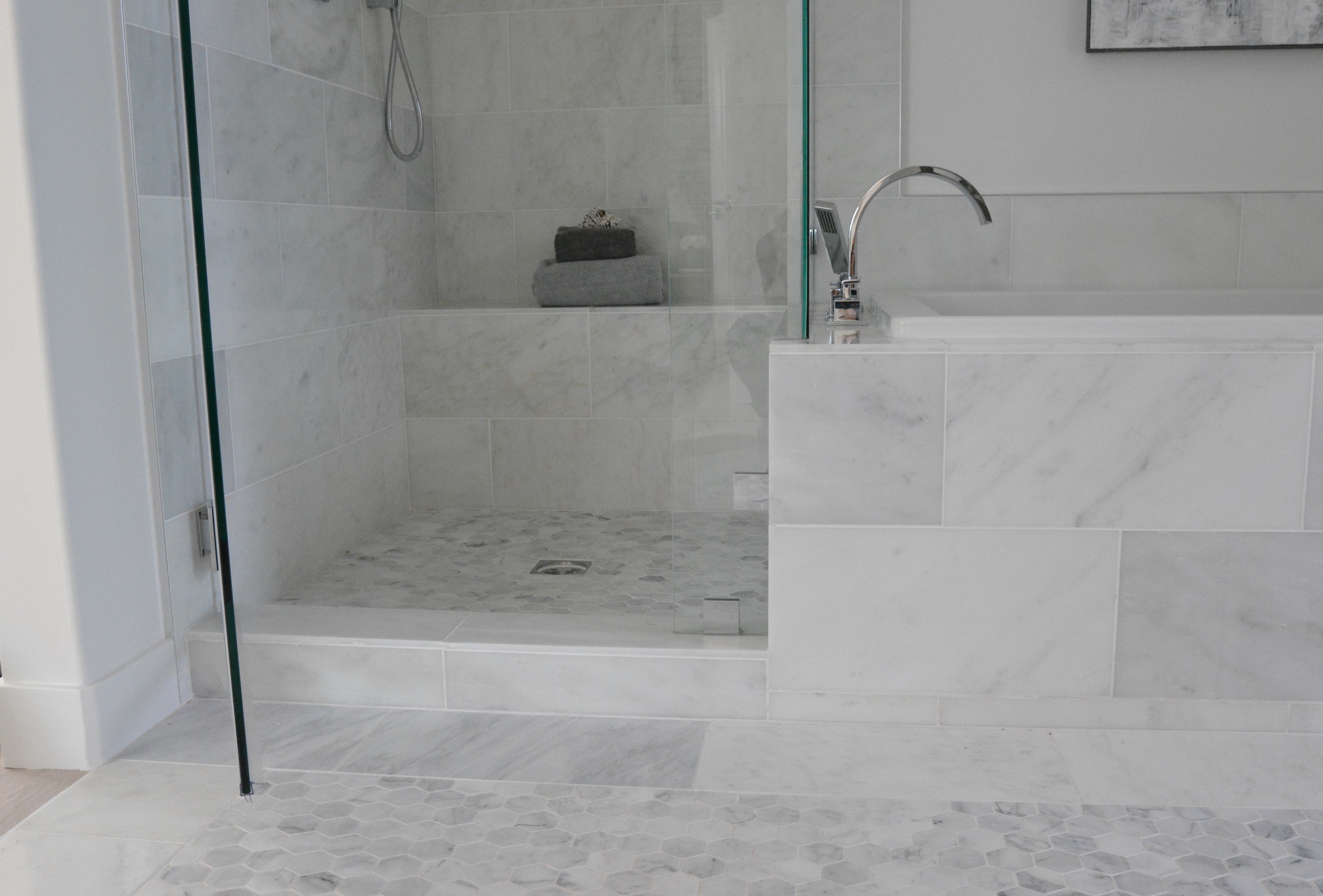 Marble tub and shower hex tile