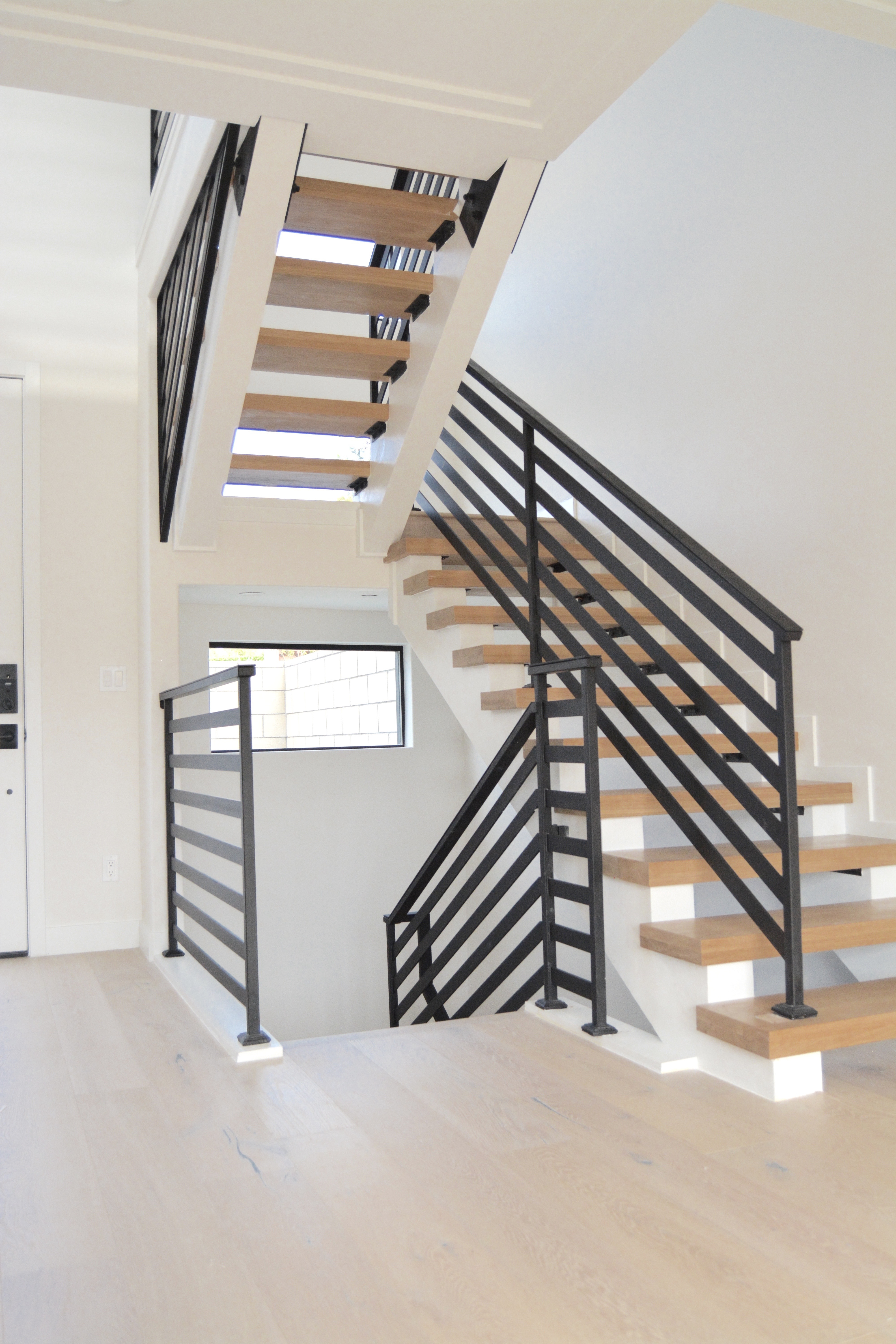 Modern black stair railing floating stairs twg contracting fish and arrow interiors