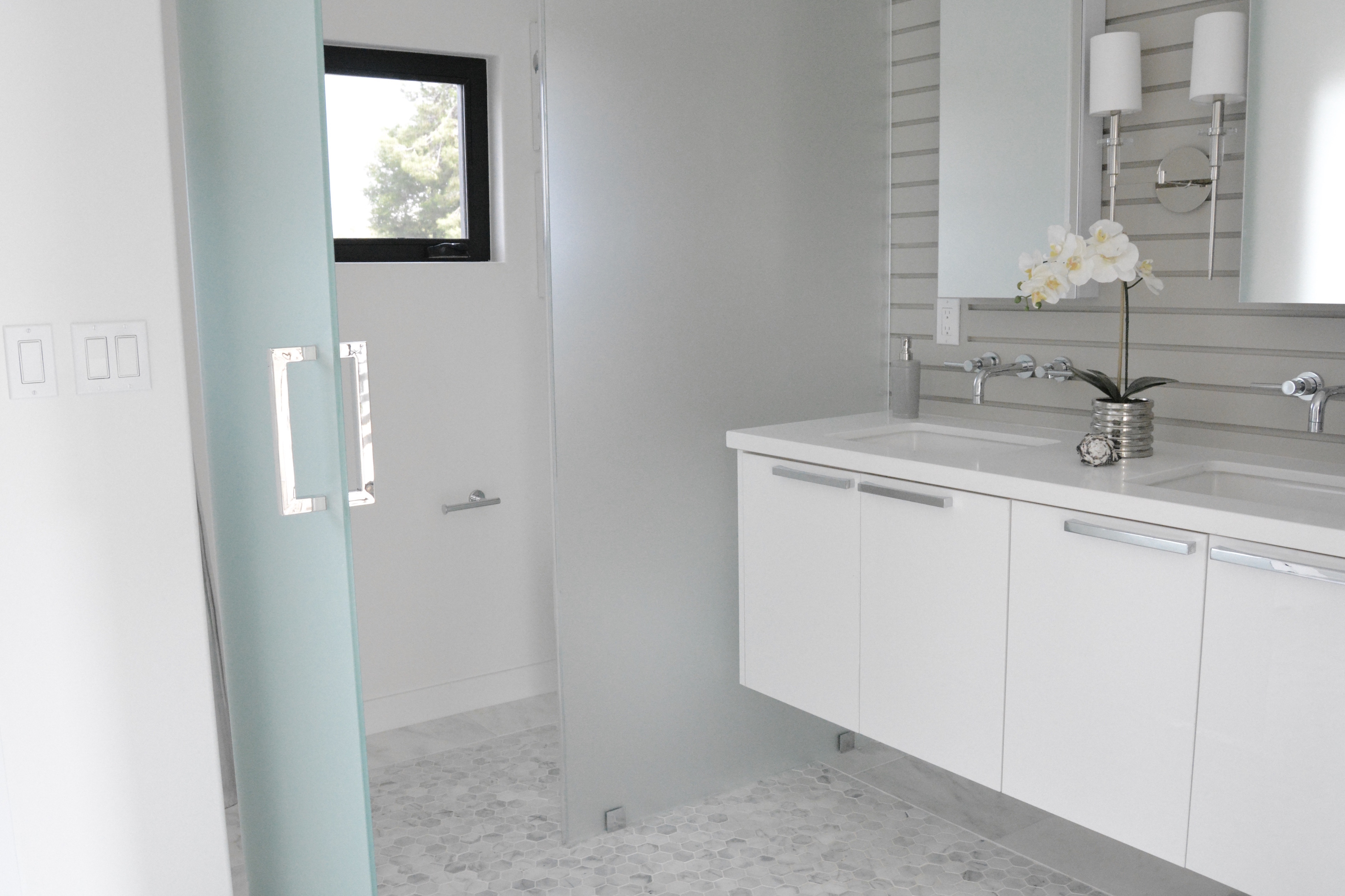 Modern white and gray bathroom floating vanity marble floors