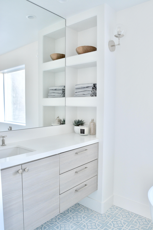 built in shelves vanity white blue tile polished nickel faucet and hardware