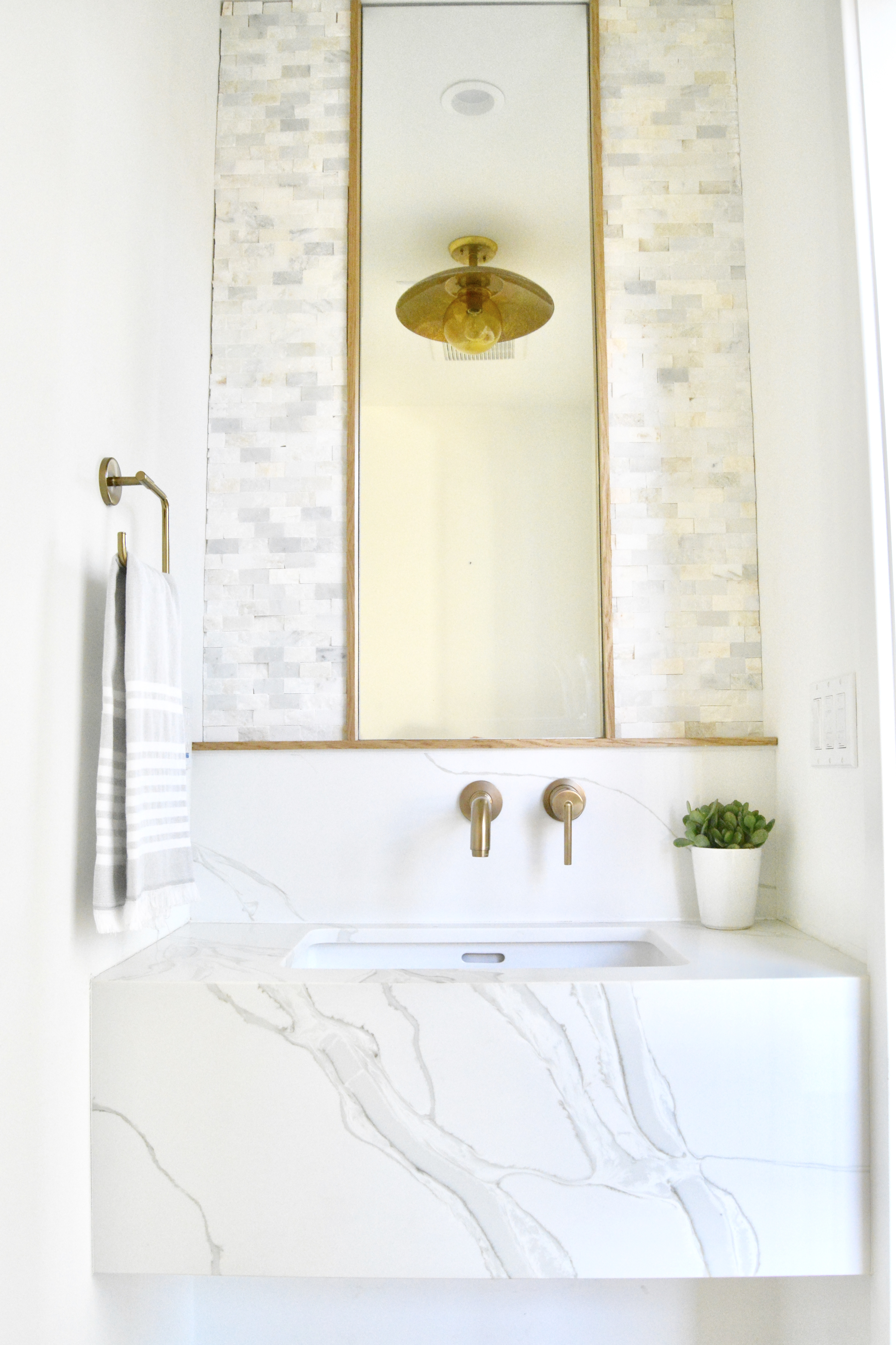 fish and arrow interiors janna parr floating marble vanity brass fixtures