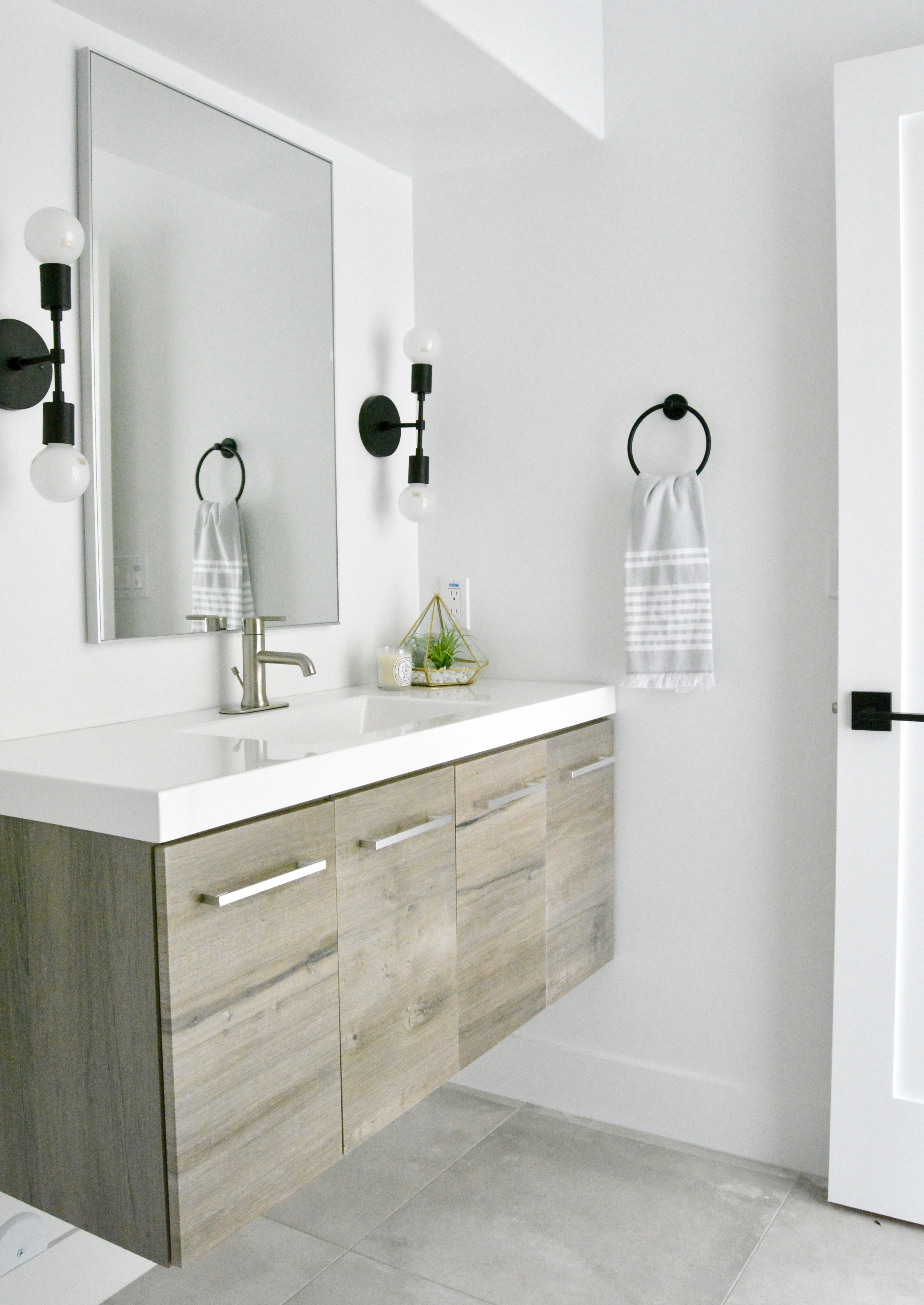 modern floating vanity wood grain black sconces black white gray ...