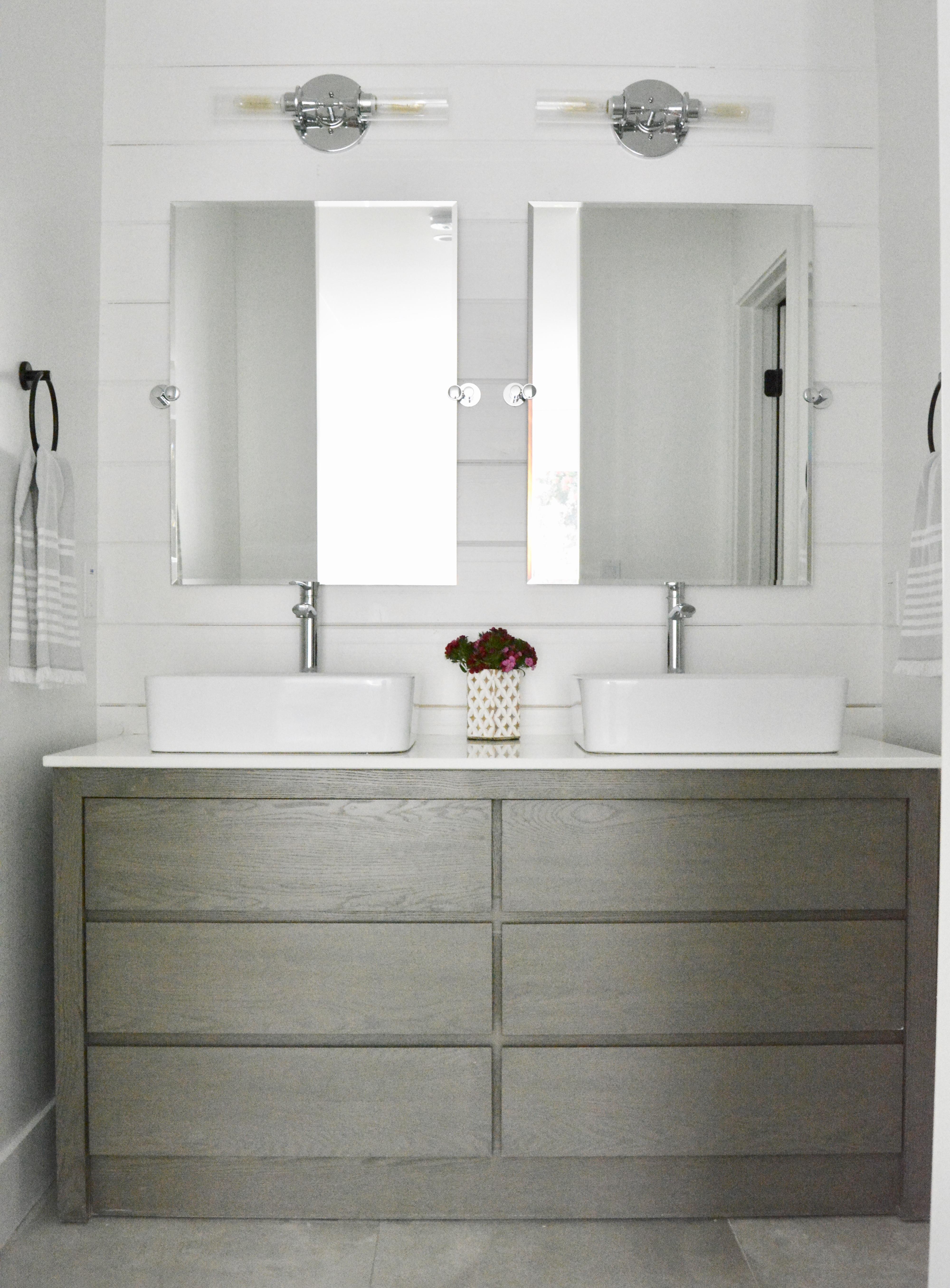 white shiplap bathroom wood vanity vessel sinks industrial lighting mixed metals fish and arrow interiors janna parr